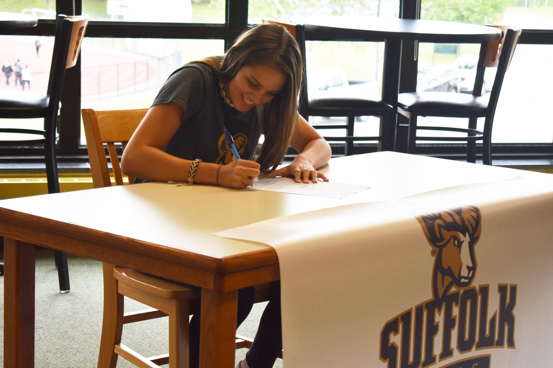Shaylen Amaral Athletic Signing and smiling