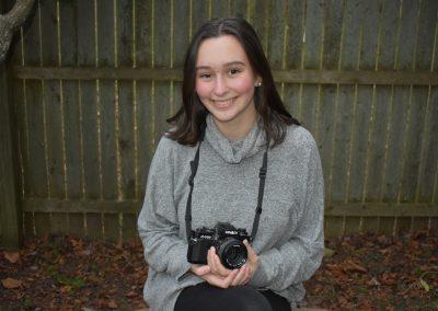 olivia smiling holding camera
