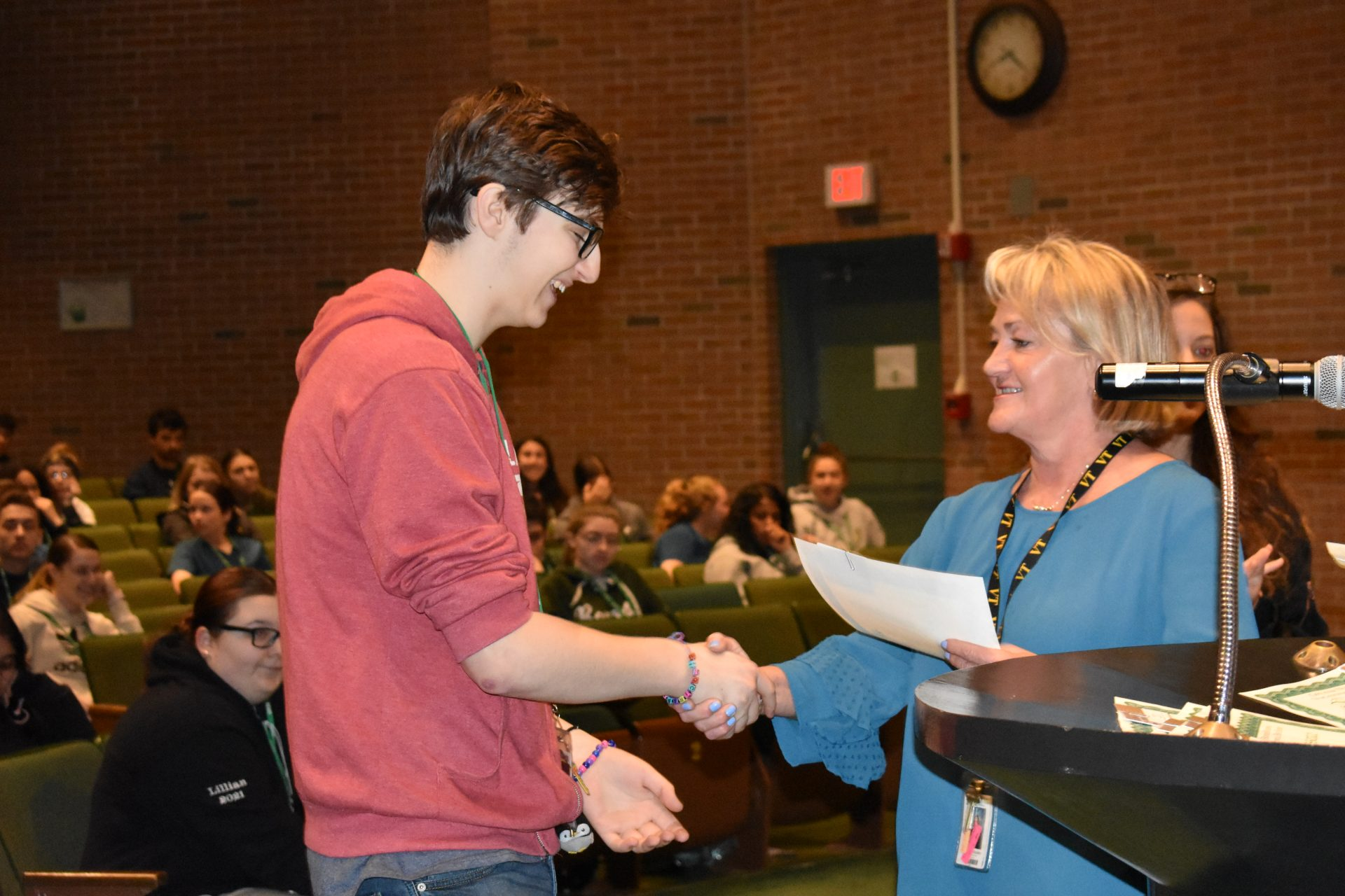 Renaissance Awards Ms. Bouley shaking a students hand