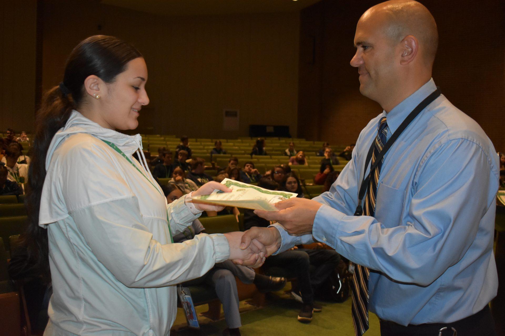 Renaissance Awards Mr. Viera gives a certificate
