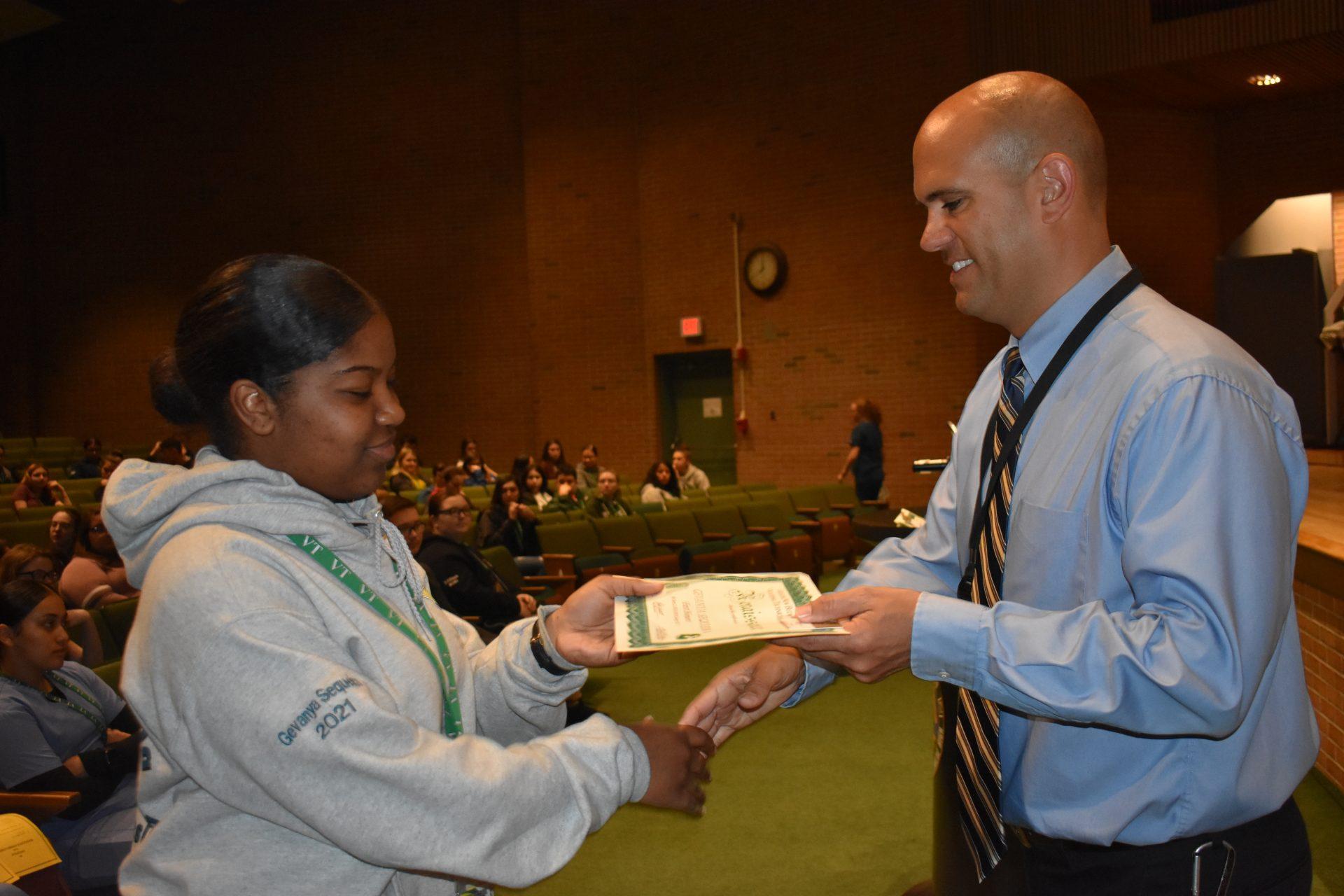 Renaissance Awards Mr. Viera gives an award