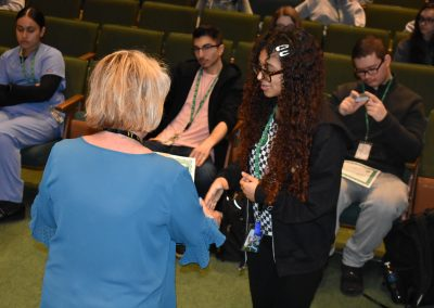 Renaissance Awards Ms Bouley shakes a students hand