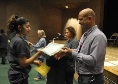 Student being handed two awards