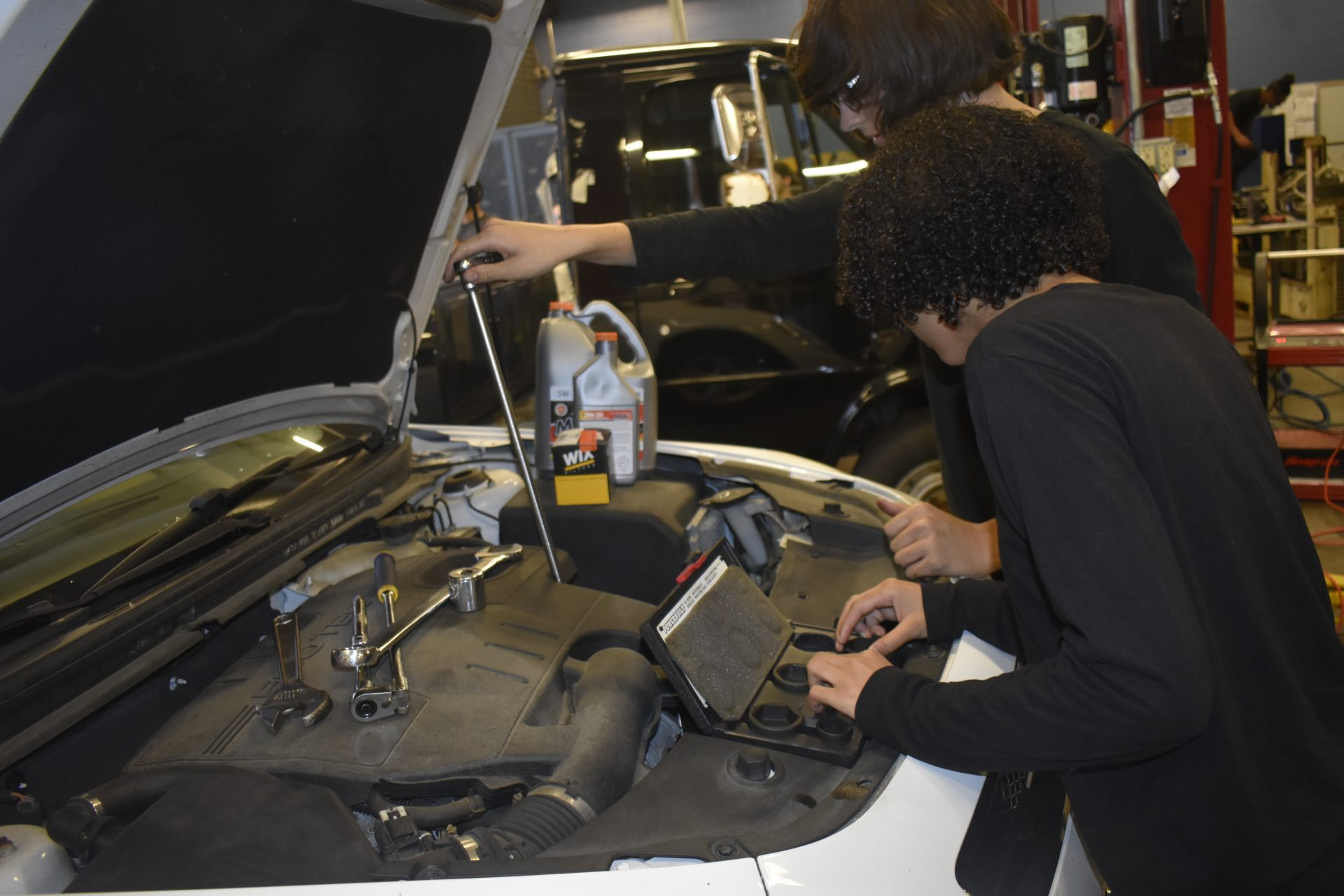 Diesel 2 students fixing a car