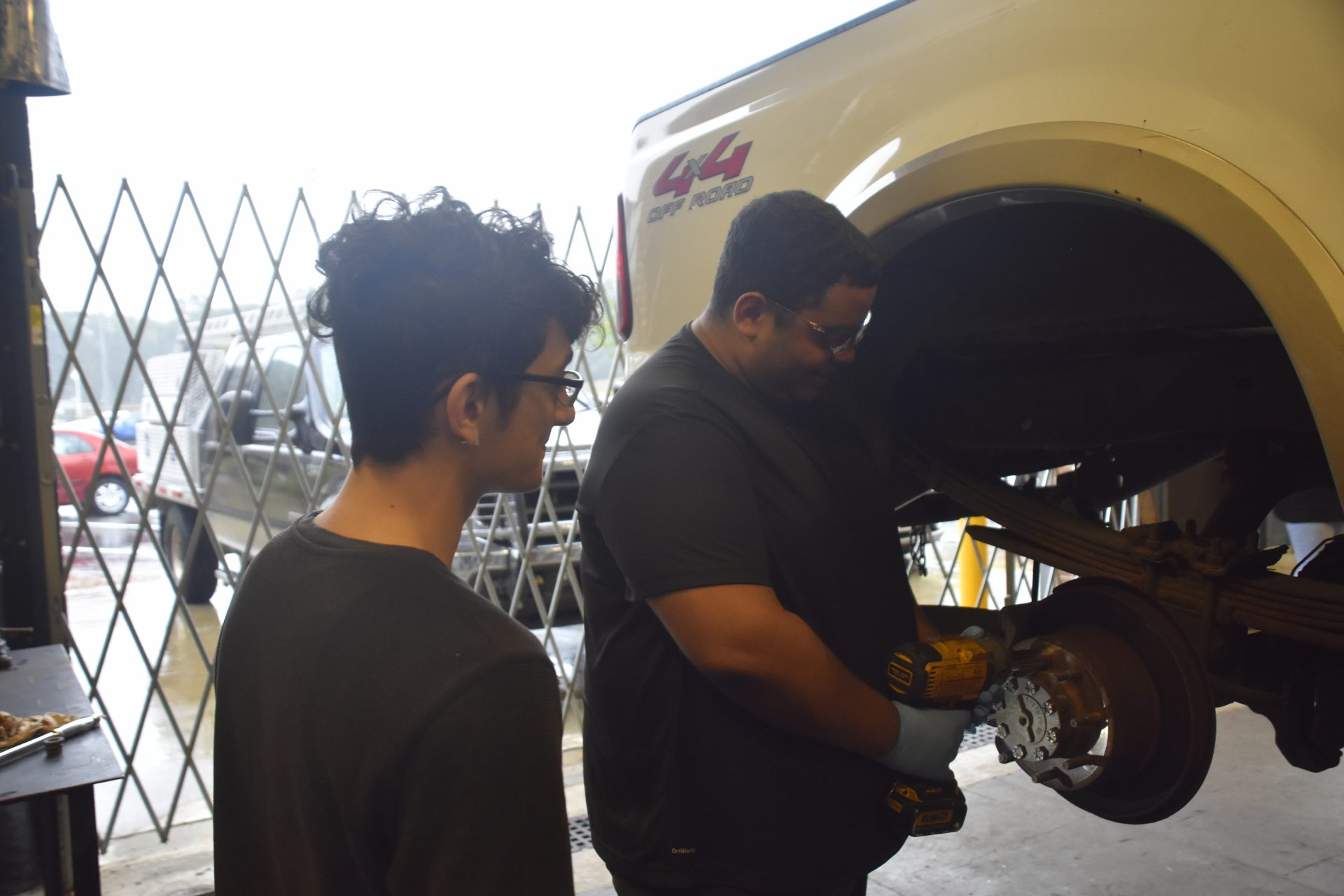 Diesel 2020 STudents Working on Car Tire