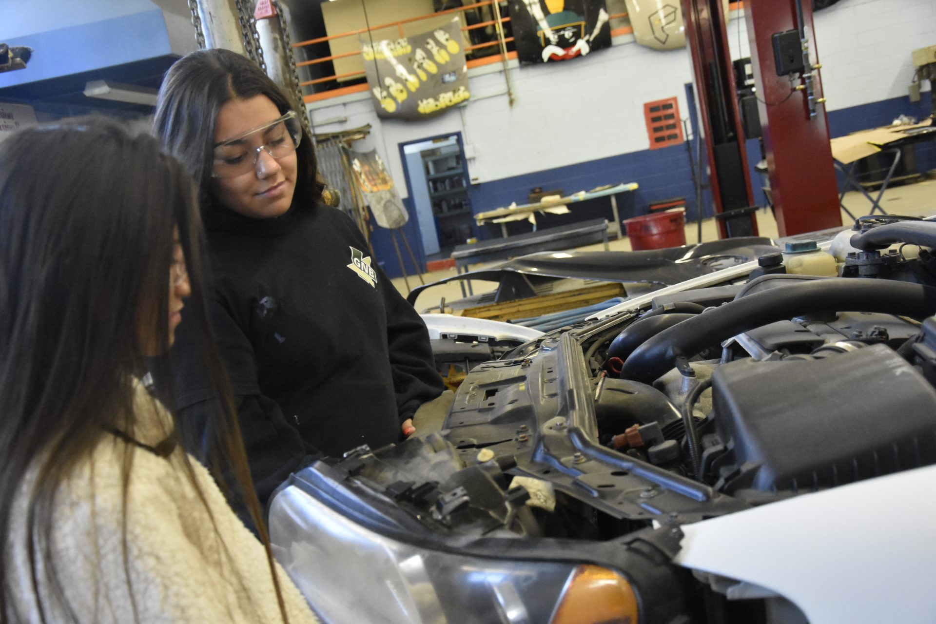 Students observing an engine