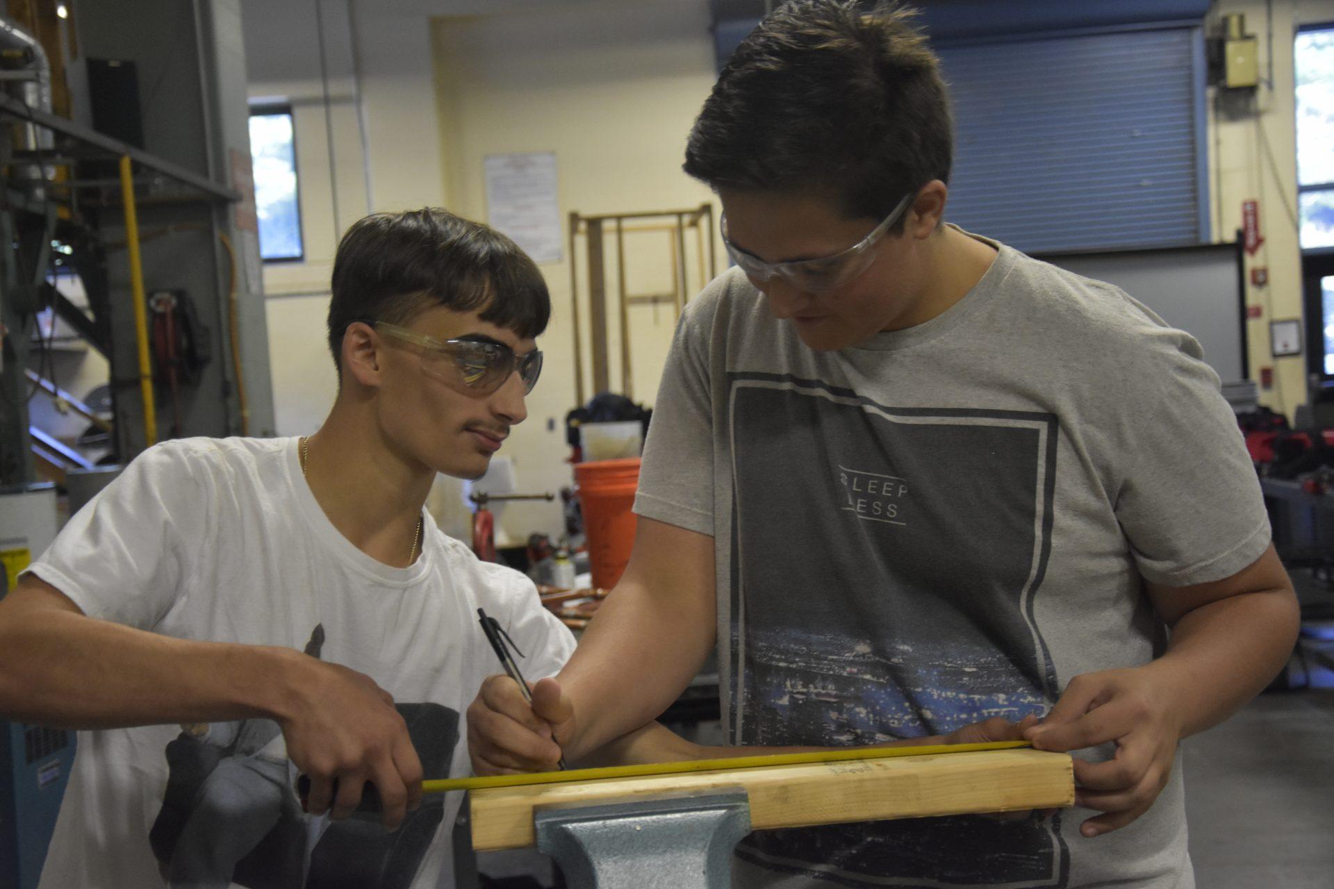 Kids measuring wood