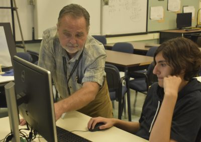 Mech 2020 Teacher Helping Student on Monitor