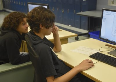 Mech 2020 Two Students Looking at Blueprint