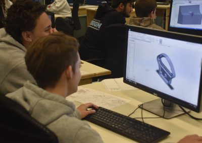 Mech 2020 Two Students Looking at Model