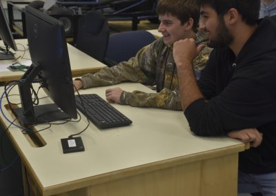 Mech 2020 Two Students Looking at Monitor