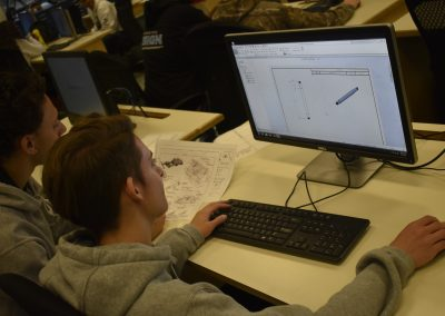 Mech students building a pipe on computer