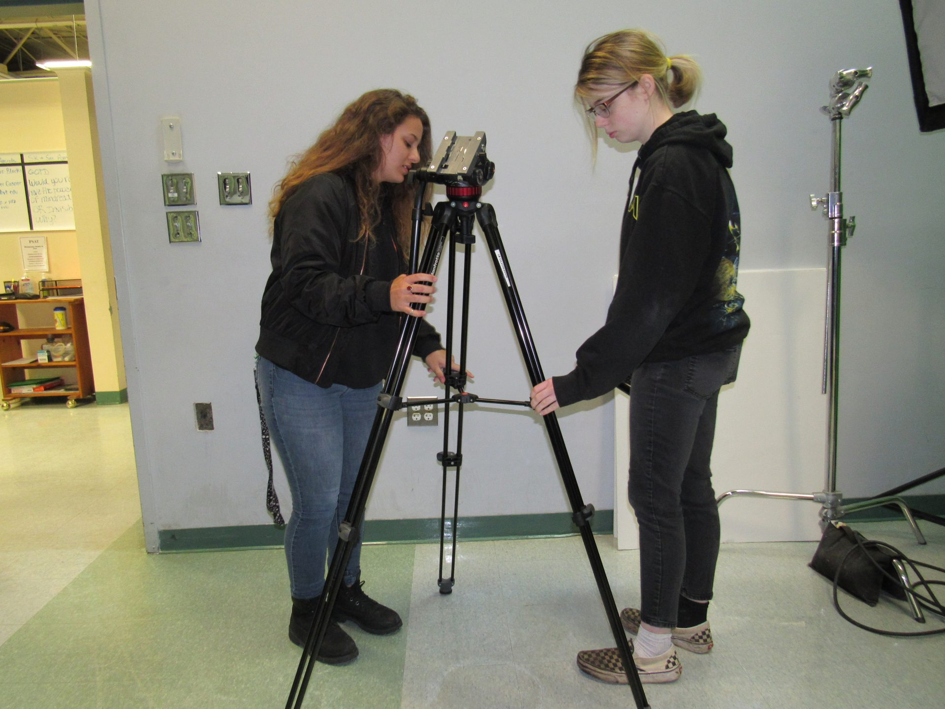 Media students setting up tripod