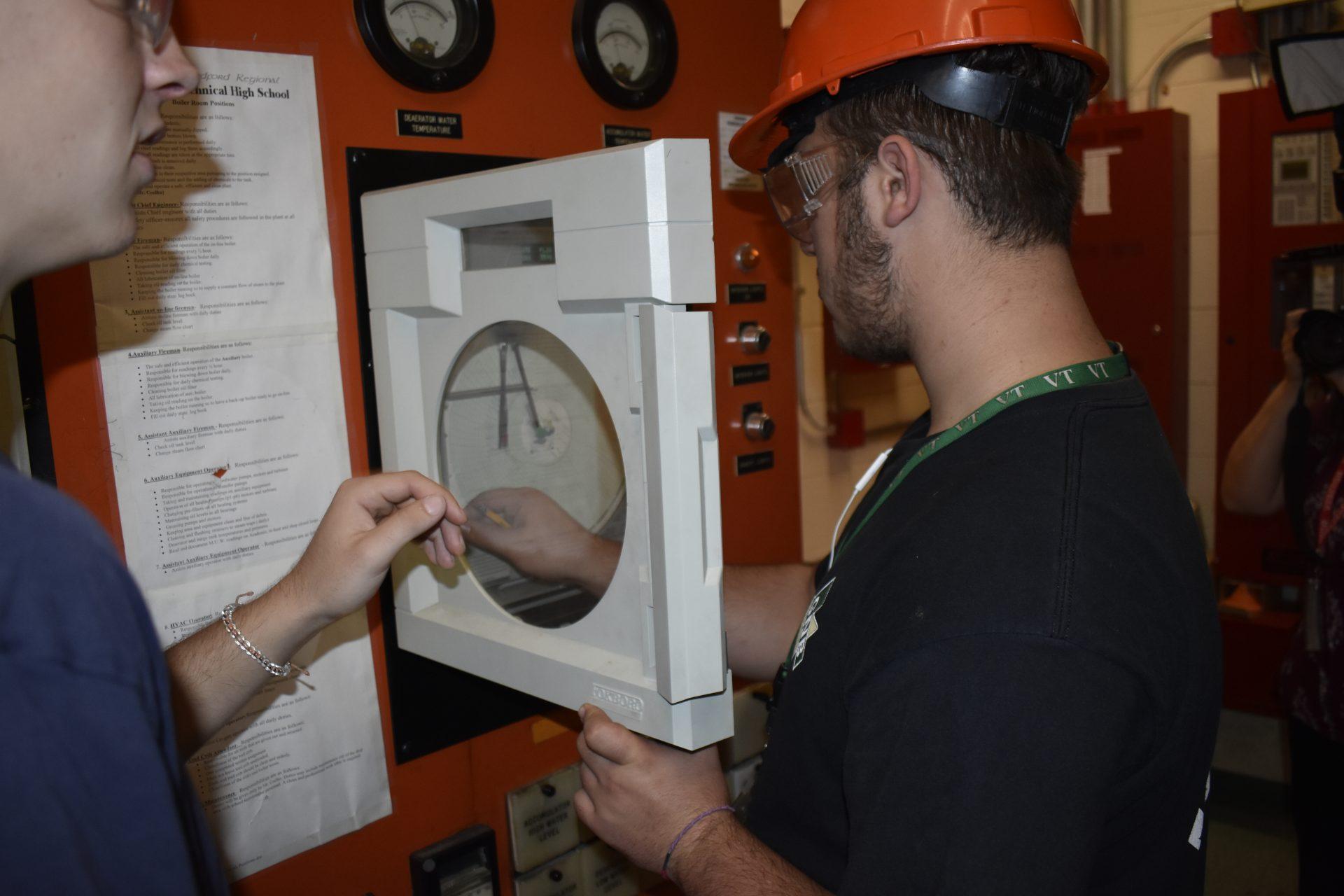 station 2 students checking pressure