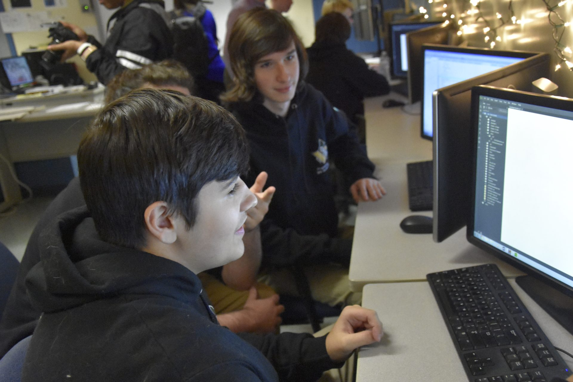 student smiling at computer