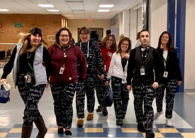 A group of teachers dressed up for pajama day