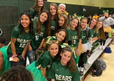 Lady bears on bleachers