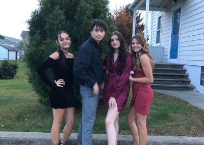 Homecoming Group Photo of four students