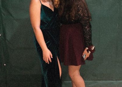 Two shot of friends at homecoming