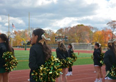 Cheerleaders facing the game