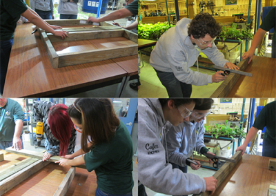 Environmental students cutting wood and building