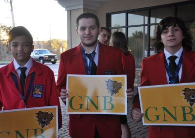 "some students holding a ""gnb"" sign"