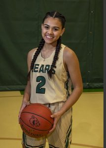MS Girl Basket Ball Player smiling with ball