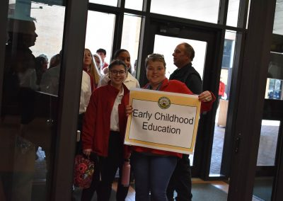 Early Childhood Education Group Walking Into Building