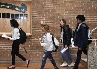 Students Walking Towards Auditorium