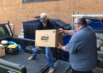 gnbvt donates food to Local food pantry bringing it into truck