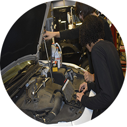 Diesel students working on a car