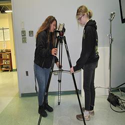 media students setting up tripod